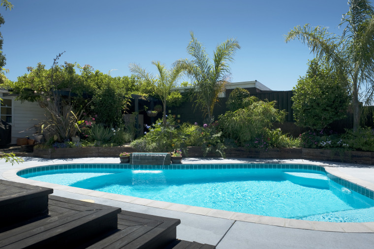 view a pool built and designed by Pool backyard, estate, home, house, landscape, landscaping, leisure, plant, property, real estate, resort, swimming pool, tree, villa, water, water feature, yard, teal