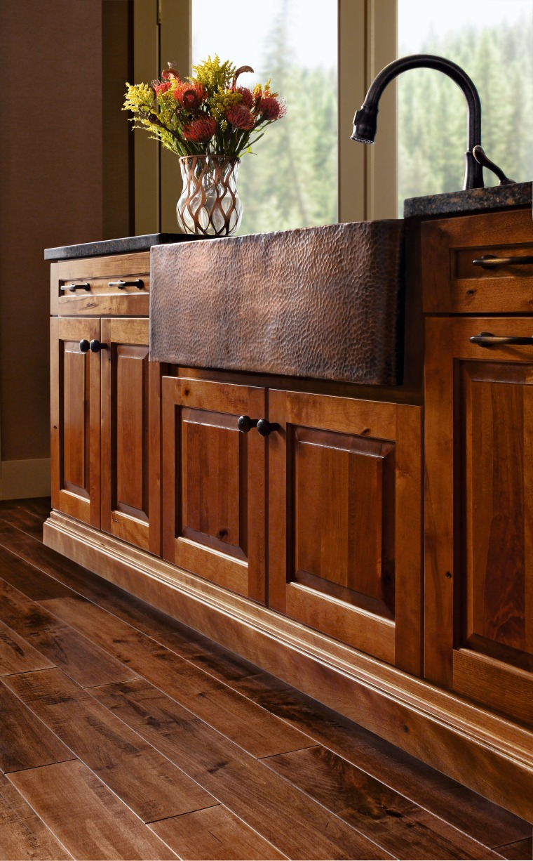 View of a kitchen which features cabinetry available cabinetry, chest of drawers, drawer, floor, flooring, furniture, hardwood, home, interior design, laminate flooring, sideboard, table, wood, wood flooring, wood stain, brown