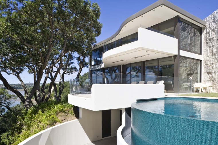 Exterior view of A Waterside house made of architecture, estate, home, house, property, real estate, swimming pool, villa, white