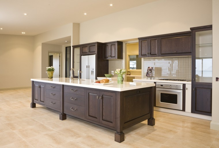 View of a kitchen which designed by a cabinetry, countertop, cuisine classique, floor, flooring, hardwood, interior design, kitchen, real estate, room, wood flooring, orange