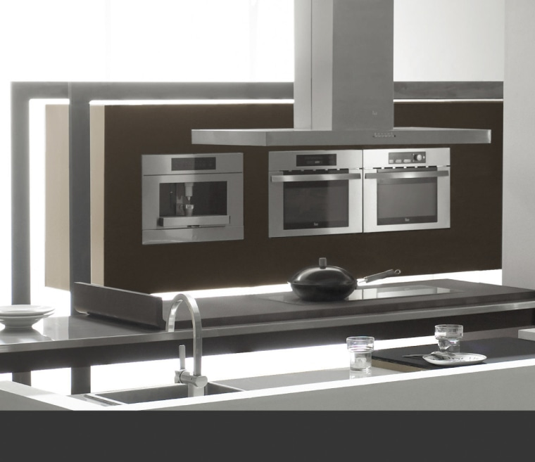 View of a modern kitchen which features appliances furniture, kitchen stove, product design, table, black, white, gray