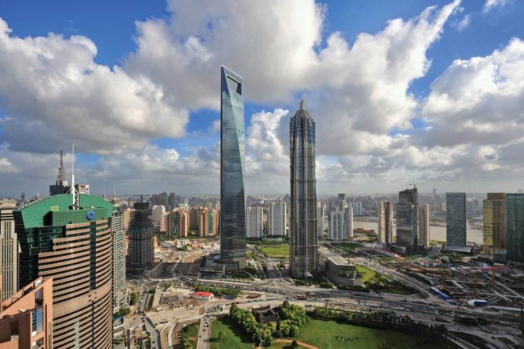 View of the Shanghai World Financial Centre in bird's eye view, building, city, cityscape, cloud, condominium, corporate headquarters, daytime, downtown, horizon, landmark, metropolis, metropolitan area, mixed use, sky, skyline, skyscraper, tower, tower block, urban area, gray