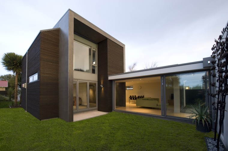 Exterior view of a family home built by architecture, elevation, estate, facade, home, house, property, real estate, residential area, brown, white