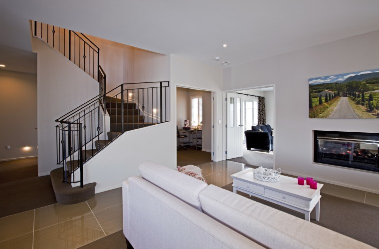 View of main living area and stairway of apartment, estate, home, house, interior design, living room, penthouse apartment, property, real estate, room, gray