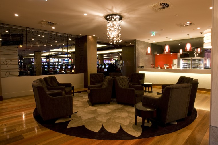 View of contemporary bar which features seating, a café, interior design, lobby, restaurant, brown, black