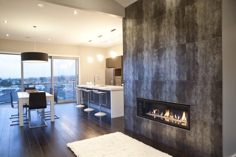 interior view of the New David Reid show ceiling, fireplace, floor, flooring, interior design, interior designer, living room, wall, orange