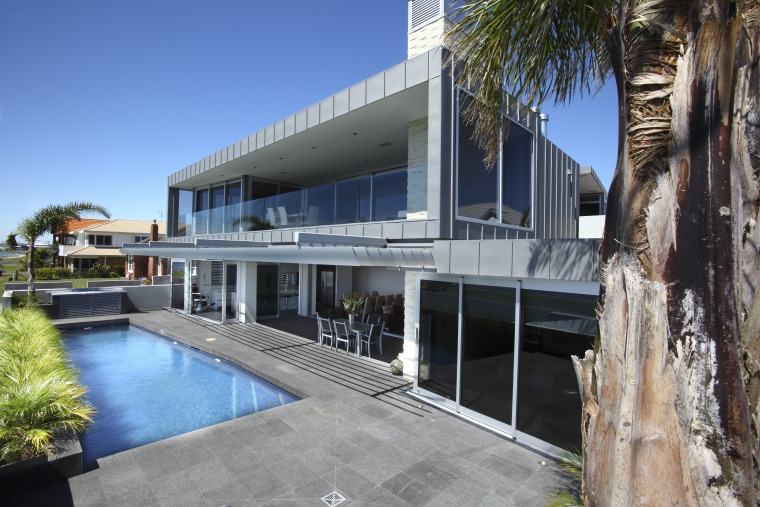 Zinc cladding featuring an angled seam, manufactured and apartment, architecture, building, condominium, house, property, real estate, villa, gray, teal