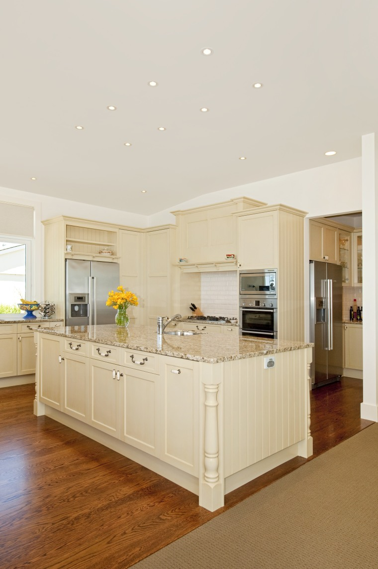 The kitchen, also by Fyfe Kitchens, features traditional cabinetry, ceiling, countertop, floor, flooring, hardwood, home, interior design, kitchen, real estate, room, white