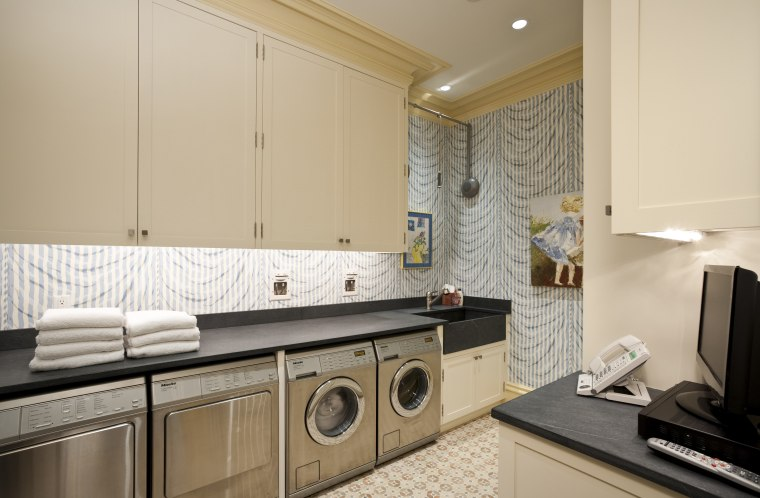 Interior view of this laundry area which features countertop, home, interior design, kitchen, laundry, laundry room, property, real estate, room, orange