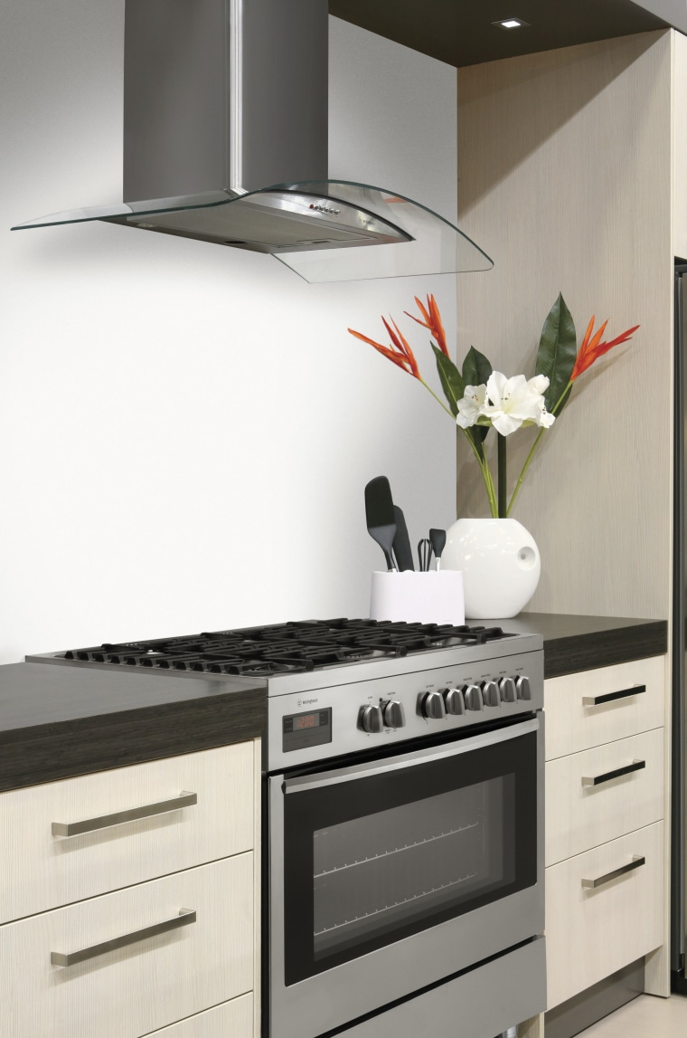 This chic kitchen features a bottom-mount refrigerator, oven, countertop, home appliance, interior design, kitchen, kitchen appliance, kitchen stove, major appliance, microwave oven, product, product design, small appliance, white