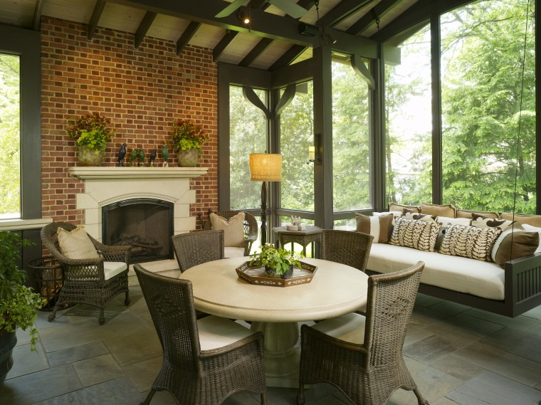 Traditional style living area featuring fireplace & furniture backyard, home, interior design, living room, outdoor structure, patio, porch, real estate, table, window, brown