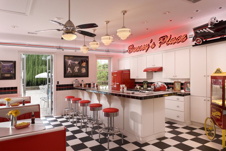 View of retro-styled kitchen featuring black and white countertop, interior design, kitchen, real estate, gray, red