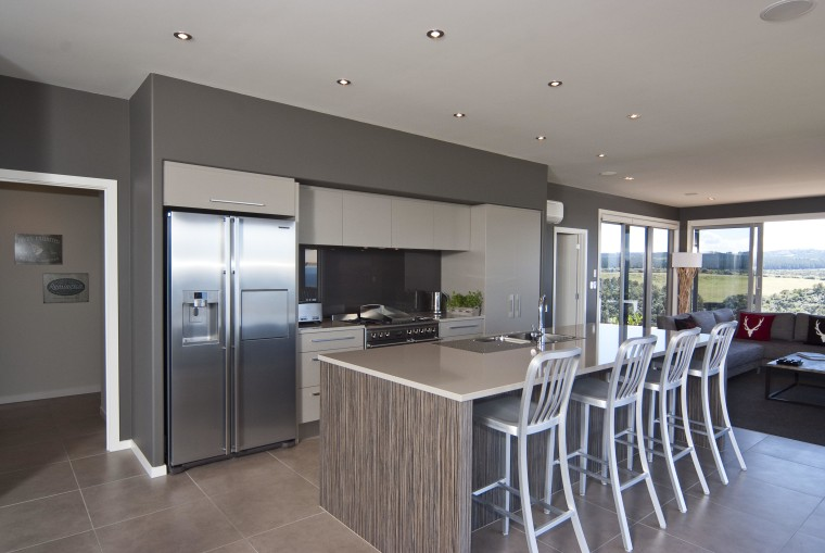 View of the kitchen area which features an countertop, floor, interior design, kitchen, property, real estate, gray