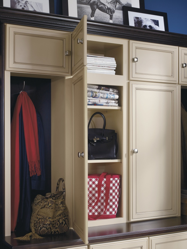 View of a bedroom which features cabinetry from cabinetry, closet, furniture, product, wardrobe, gray, black, brown