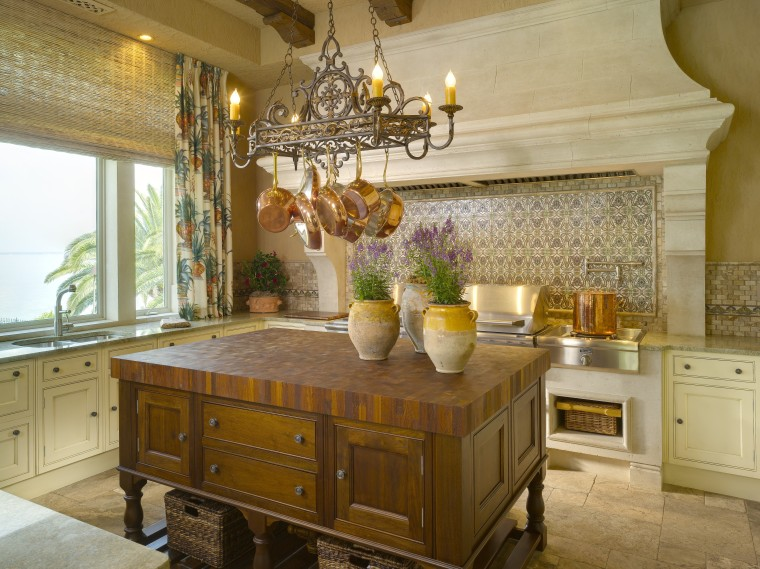 View of a traditional-styled kitchen which features a cabinetry, countertop, cuisine classique, home, interior design, kitchen, room, brown, orange