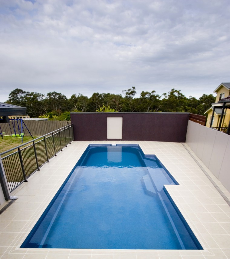 Exterior view of the pool area backyard, estate, house, leisure, property, real estate, sky, swimming pool, water, gray