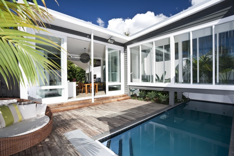 View of this modern home apartment, architecture, estate, home, house, property, real estate, swimming pool, villa, window, white