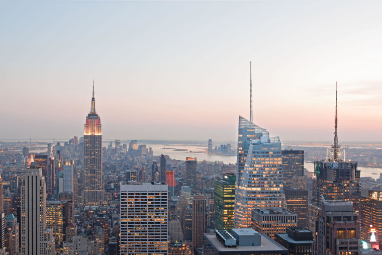 View of the Bank of America Tower in building, city, cityscape, dawn, daytime, downtown, dusk, evening, horizon, landmark, metropolis, metropolitan area, morning, sky, skyline, skyscraper, sunset, tower, tower block, urban area, white