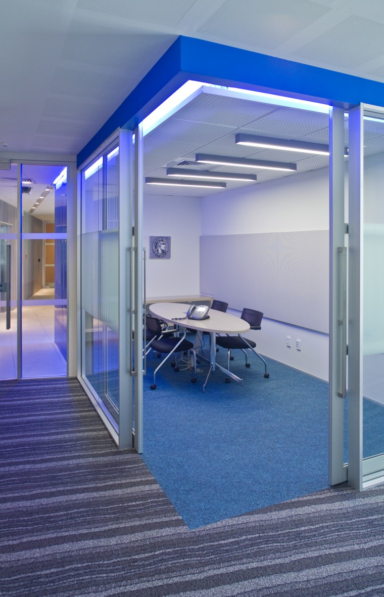 Interior view of offices which features glass cavity architecture, daylighting, floor, glass, leisure centre, real estate, structure, blue