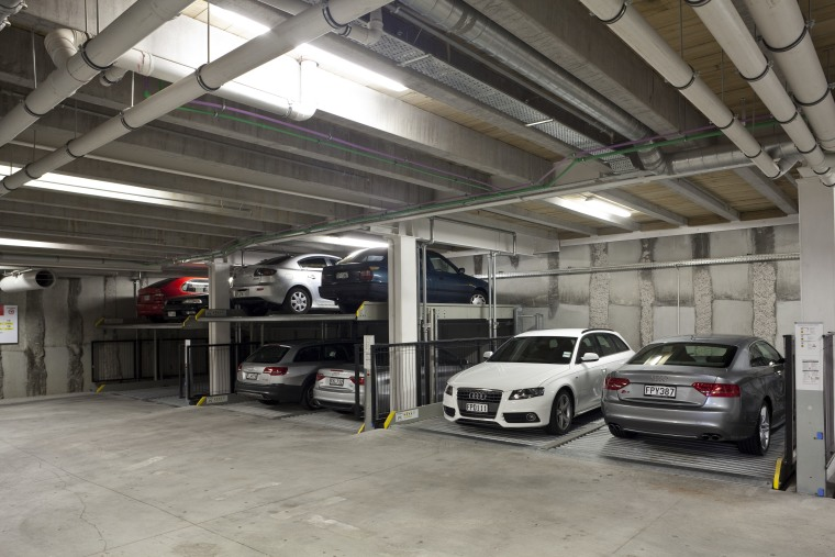 View of the underground car parking at the audi, automobile repair shop, automotive design, automotive exterior, building, car, executive car, family car, garage, luxury vehicle, motor vehicle, parking, parking lot, personal luxury car, vehicle, gray, black