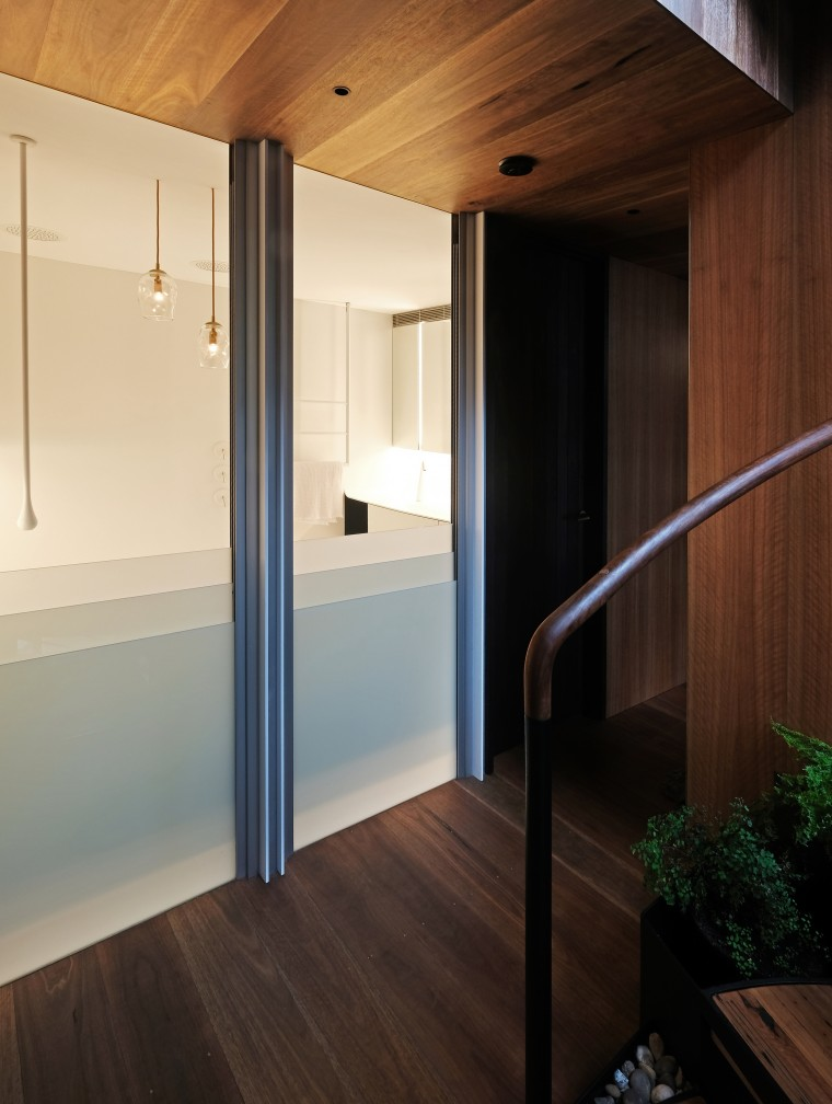 This bathroom's predominantly smooth, white elements, contribute to architecture, building, ceiling, door, floor, flooring, furniture, glass, hardwood, home, house, interior design, laminate flooring, loft, property, room, wall, wood, wood flooring, brown