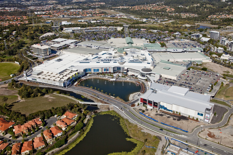 Exterior view of the Robina Town Centre where aerial photography, bird's eye view, city, metropolitan area, photography, real estate, residential area, suburb, urban area, urban design, water, waterway, gray, brown