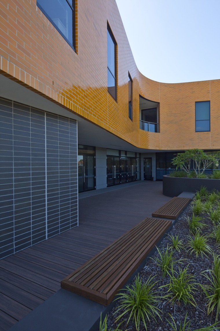 Exterior view of the Poche Centre which was apartment, architecture, building, elevation, estate, facade, home, house, property, real estate, residential area, siding, sky, window, blue