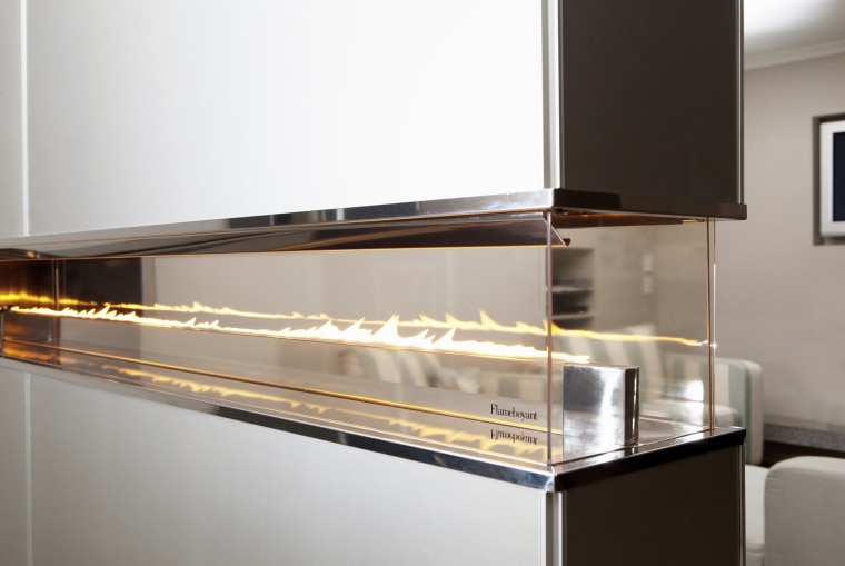 View of a contemporary all-glass, fueled fireplace by furniture, glass, product design, white