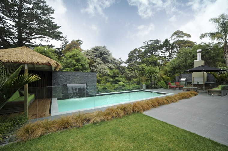 Exterior view of an outdoor area which features area, arecales, backyard, cottage, estate, hacienda, home, house, landscape, leisure, palm tree, property, real estate, residential area, resort, swimming pool, villa, yard