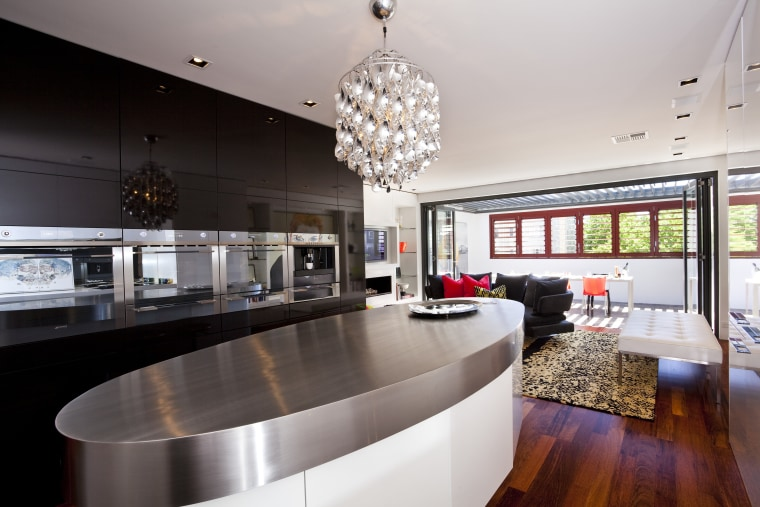 View of kitchen with oval bench top. countertop, interior design, kitchen, table, gray, black
