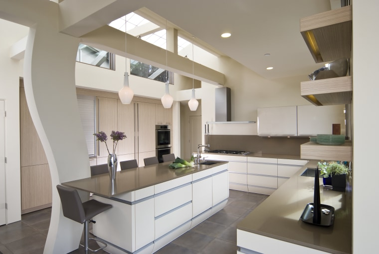 View of neutral-toned kitchen and dining space, featuring cabinetry, countertop, cuisine classique, interior design, kitchen, real estate, room, gray