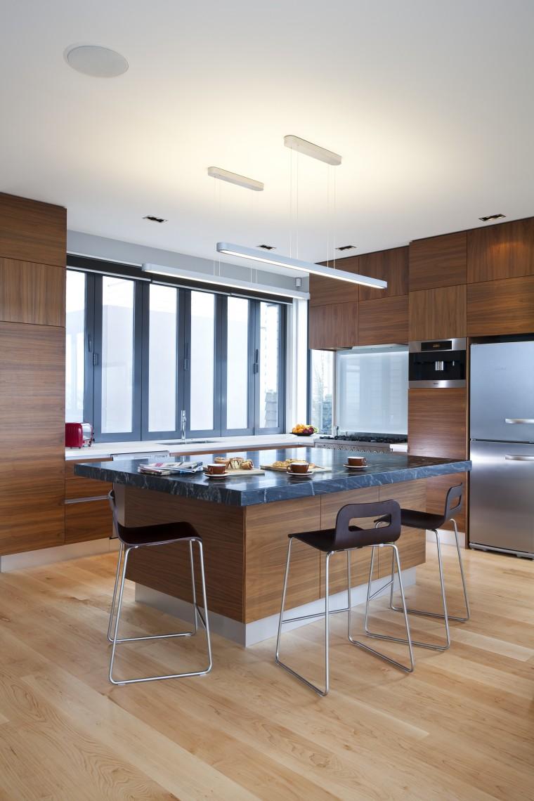 Designer Shane George. Open-plan space. Small amount of countertop, floor, flooring, furniture, hardwood, interior design, kitchen, laminate flooring, room, table, wood, wood flooring, white