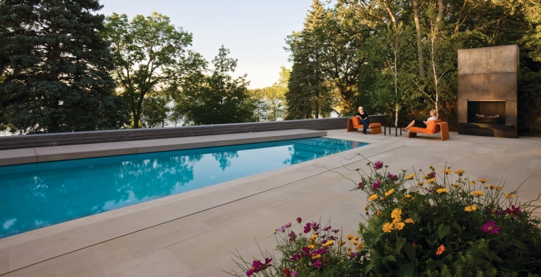 View of pool area. backyard, estate, home, leisure, outdoor structure, property, real estate, swimming pool, brown, gray