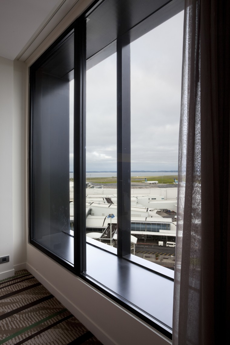 View from suite at the Novotel Auckland Airport door, glass, interior design, window, black, gray
