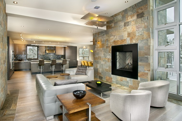 The interior of this home was designed by ceiling, interior design, interior designer, living room, real estate, wall, gray