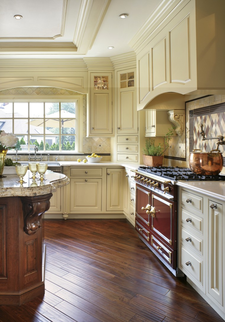 View of kitchen designed by Antoinette Fraser of cabinetry, countertop, cuisine classique, floor, flooring, hardwood, home, interior design, kitchen, room, window, wood, wood flooring, white, brown