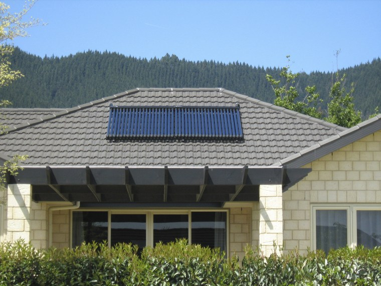 This large home efficiently uses solar energy thanks daylighting, energy, facade, home, house, outdoor structure, real estate, roof, solar energy, solar panel, solar power, gray, teal