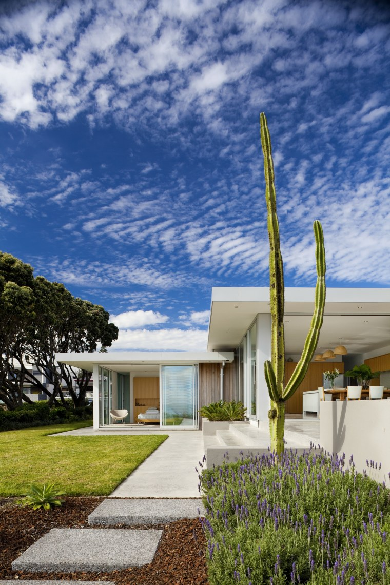 exterior shot of house form lawn. 1950s style. architecture, cloud, estate, facade, home, house, real estate, residential area, sky, blue