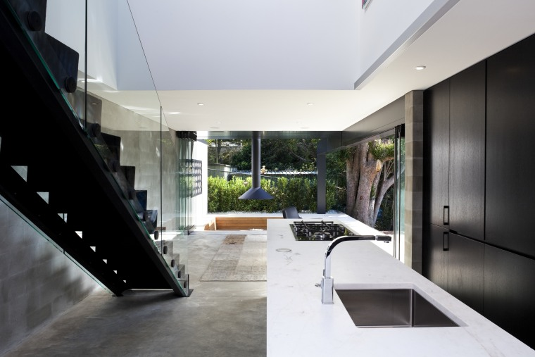 Kitchen near stairs. White countertop, black cabinetry. See architecture, house, interior design, white, black