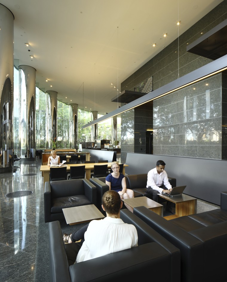 Seating area with black seats. furniture, interior design, lobby, restaurant, black, gray
