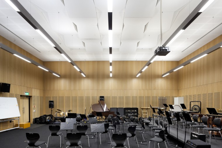 Room with wooden walls, black flooring and black architecture, auditorium, ceiling, classroom, conference hall, daylighting, interior design, white