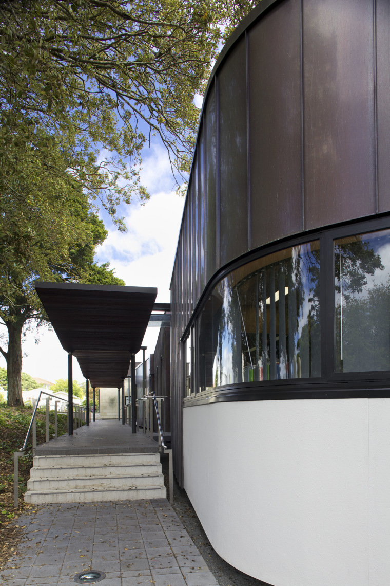 Exterior with curved windows. architecture, building, facade, house, reflection, tree, black, gray