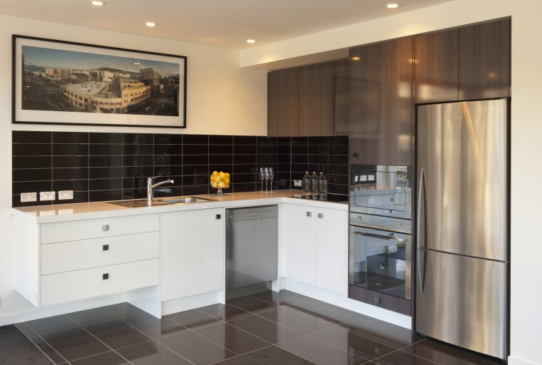 Kitchen with stainless fridge and white drawers and cabinetry, countertop, cuisine classique, interior design, kitchen, property, real estate, room, white