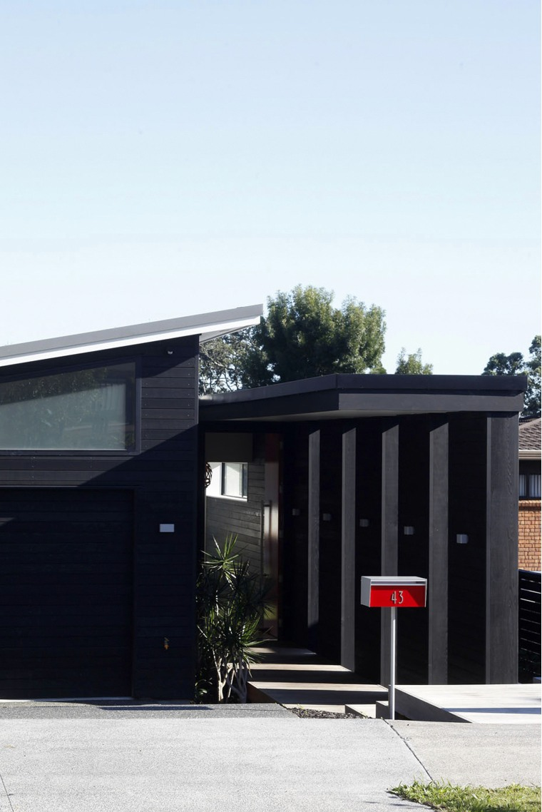 Exterior of townhouse painted in Resene colours, black architecture, building, facade, home, house, real estate, residential area, white, black
