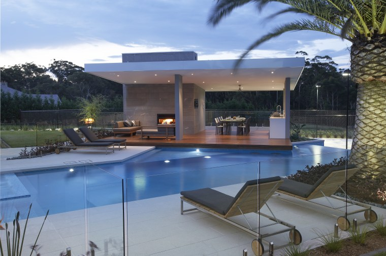 This pool pavilion has a wood deck that backyard, estate, home, house, property, real estate, resort, swimming pool, villa, teal, gray