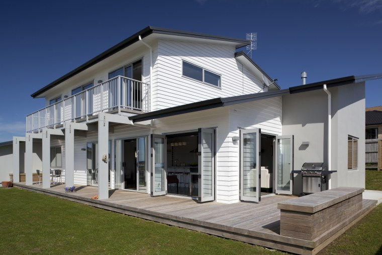 The Palliside weatherboard cladding system provides a clean, building, elevation, estate, facade, home, house, official residence, property, real estate, residential area, siding, villa, window, gray, blue
