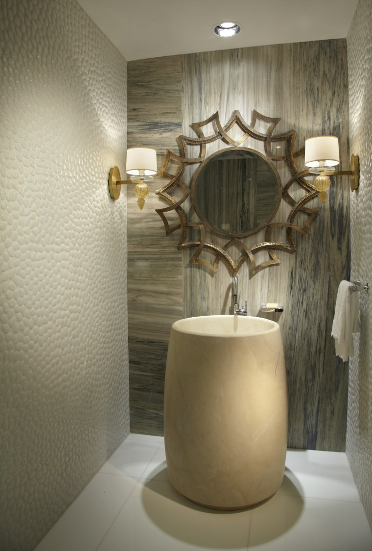 This powder room's focus is it's basin, which bathroom, ceiling, ceramic, flooring, interior design, light fixture, product design, room, wall, brown, gray