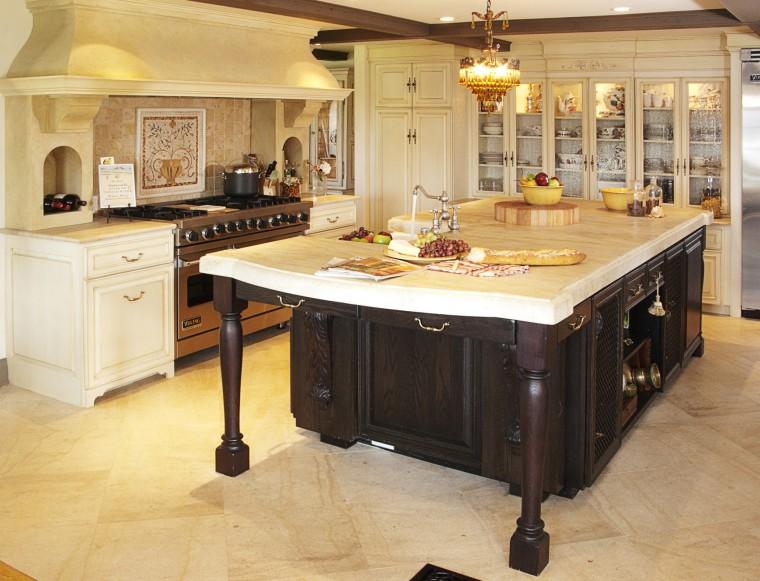 The dark-stained, oak island, which has a distinctive cabinetry, countertop, cuisine classique, floor, flooring, furniture, hardwood, interior design, kitchen, room, table, wood flooring, orange
