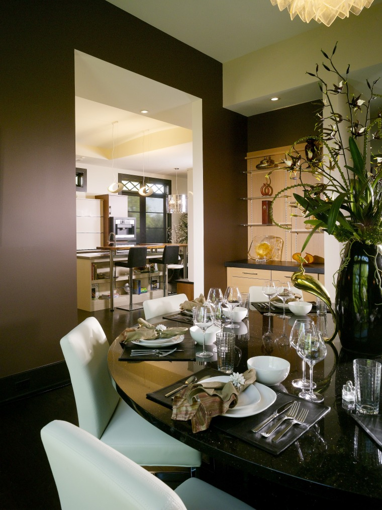 This formal dining area is positioned beside a dining room, furniture, home, interior design, living room, restaurant, room, table, brown