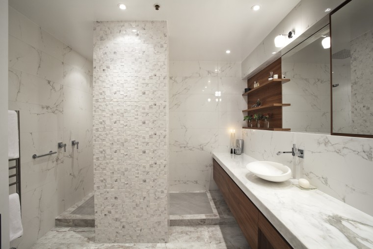 This internal bathroom in a penthouse apartment was bathroom, floor, interior design, property, room, sink, tile, gray